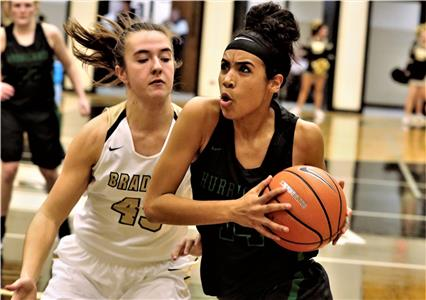 Madison Hayes of East Hamilton drives past a Bradley Central defender Tuesday night during their District 5-3A basketball game in Cleveland. Hayes scored a team-high 16 points and grabbed seven rebounds in a 63-36 loss.