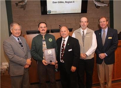 Dan Gibbs (second from left) holds his award for being named Tennessee Wildlife Resources Agency Biologist of the Year for 2017. Pictured (from left) are Ed Carter (TWRA Executive Director), Gibbs, Mark Gudlin (TWRA Wildlife and Forestry Division Chief), John Mike (Region IV Wildlife Manager) Jeff Cook (Tennessee Fish and Wildlife Commission Vice Chairman).