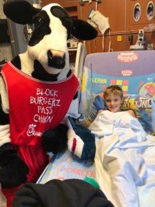 The Chick-fil-A cow visits Isaac Miller at Children's Hospital at Erlanger