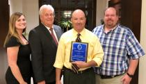 Jim McDonald holds his plaque after being named Volunteer/Citizen of the Year by the Emergency Management Association of Georgia. With him are from left, Whitfield EMA officials Amy Ramsey, Claude Craig, and Jeff Ownby.