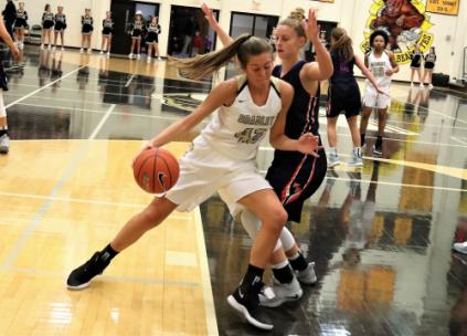 Bradley Central junior Anna Walker makes a move for the goal Tuesday night against a William Blount defender in their high school basketball game Thursday night in Cleveland. Walker scored a game-high 17 points as the Bearettes romped to a 58-18 victory, the 2,200th all-time in the program's history.