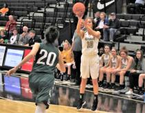 Bradley Central's get off a shot before Creekview's Savannah Burke can contest the two-point attempt in the Bearettes' 59-45 win over the Lady Grizzlies on Friday. The game opened the 19th Holiday Inn Express Thanksgiving tournament at Bradley Central High School. The tournament continues Saturday.