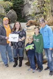 Amanda Roe from Bristol was the Tennessee Aquarium's 25-millionth guest on Saturday afternoon. They came to Chattanooga this weekend to visit the Tennessee Aquarium for the very first time. Shown are Michael, Amanda, Tyler, Jacob, and Michael Roe.