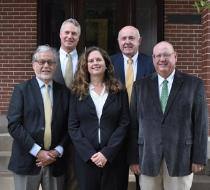 Long-time insurance advisors have joined to form Bluffview Insurance Group, which specializes in life insurance, long-term care, and employee and executive benefits. Top row, left to right, are DeForest Spencer and Larry White. Bottom row are Bob Berz, Melissa Woodall Curtis and Mike Jenkins.