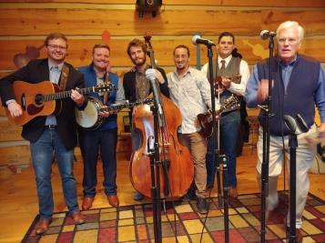 "Mountain Cove highlighted the November ""Red Back Hymnal Hymn Sing"" at the Hullander farm in Apison. The Gospel Bluegrass group has won many awards in their field and makes their home in the Chattanooga area. The group is shown with Hamilton County Trustee Bill Hullander. See story and more photos by Earl Freudenberg on Happenings."