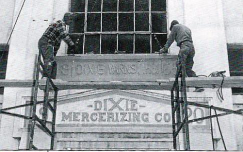 Workmen officially changing the company's original name at the Lupton City plant