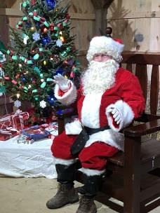 After he makes his ride through down during Friday night's parade, Santa Claus will set up shop at the Kiwanis Barn near the Nature Trail for visit with children