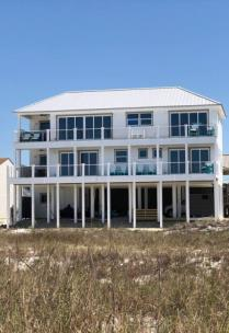 Owners of Beach House That Survived Hurricane Michael Are Making It Still Stronger