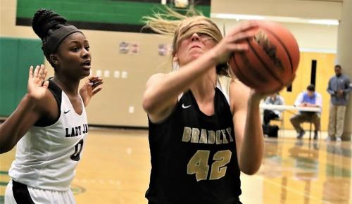 Bradley Central junior Anna Walker, right, is defended by Southwind's Jasmine Wright and her own pony tail in the Bearettes' easy 53-26 victory in the East-West Classic on Friday. Walker scored 14 points and grabbed 10 rebounds. The classic shifts to Bradley Central on Saturday with seven more games starting at 11 a.m.
