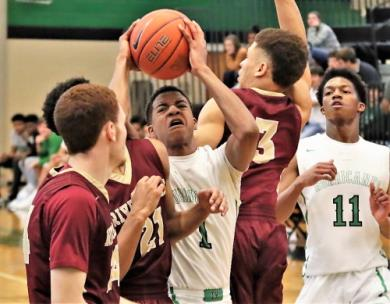 East Hamilton's Jamaal Walker, No. 1, gains control of the basketball despite having three Riverdale defenders, from left, Kai Crawford, Rahaad Thompson and C.J. Johnson during their game Friday in the second East-West Classic at East Hamilton High School. The Warriors won, 55-53.