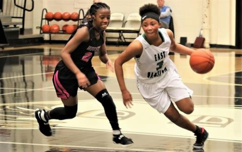 Dezah Lacy (3) of East Hamilton makes a sharp break for the basket Saturday in the Lady Hurricanes' game against talented Houston in the East-West Classic. Houston, which reached the 2017 Class 3A state tournament championship game, rolled to a 76-49 victory.