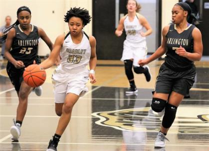 Bradley Central sophomore point guard Jamaryn Blair sprints past Arlington defenders Carmen Taylor, left, and Nya Stewart during their East-West Classic basketball game Saturday. Blair scored 21 points on 9 of 13 shooting in the Bearettes' convincing 53-32 victory.