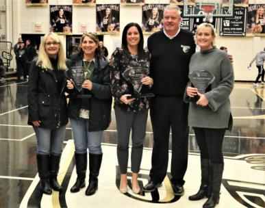 The Bradley Central High School Bearettes inducted three former stars into their Hall of Fame Saturday evening prior to their East-West Classic II contest with Arlington. Those honored, shown with Bradley's girls coach Jason Reuter  were, left to right, Alice Hancock, represented by her family, Paige Redman, Reuter, and Amy Geren McGowan.