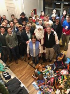 Sigma Chi contributes to the East Ridge Needy Child Fund