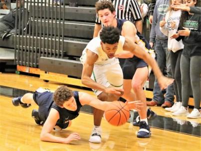 Walker Valley's diving Jordan Monck and East Hamilton guard Cameron Montgomery battle for a loose ball Tuesday during their key District 5-3A game at East Hamilton. Montgomery scored 19 points as he Hurricanes clip the previously unbeaten Mustangs, 63-58, in overtime.