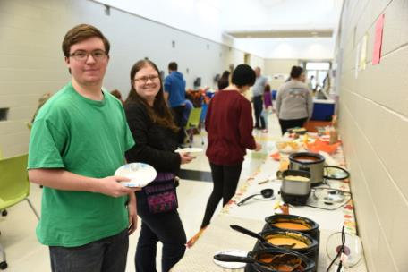 Kimball students Jonathan Sitz and Lila Evey prepare to help themselves to soup during the Bread & Words event