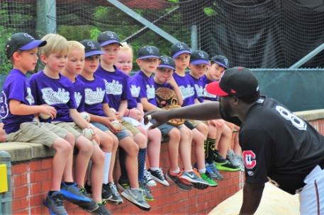 A fan-favorite, Tommy Watkins always found time to talk with youngsters who sat on the wall along third base.