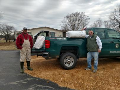 Commercial fishermen Ray Self and Billy Roberson receive their 15 TWRA-supplied gillnets.