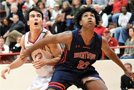 Baylor's Lorenzo White, left, and Cory Reynolds of Brentwood Academy anticipate a possible rebound during their Division II-2A basketball game Friday night at Baylor. The visiting Eagles pulled out a 61-59 overtime win after losing to the Red Raiders, 70-38 -- again in overtime -- earlier this season.