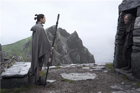 Rey (Daisy Ridley), left, confronts long-exiled Jedi Knight Luke Skywalker (Mark Hamill) at his monastery-like retreat