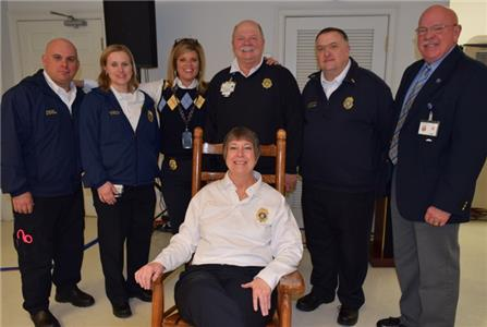 Pictured center seated HCEMS Captain Darlene Poole, left to right back row Captain Brian Bricker, Lt. Brandy Rogers, HCES PIO Amy Maxwell, HCEMS Deputy Chief John Combes, Lt. David Burdett, and Director Ken Wilkerson.
