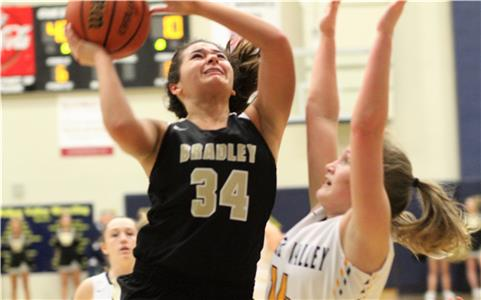 Alexis Barnes of Bradley Central shoots over Walker Valley's Mauren Baker during their Disrict 5-3A basketball tournament game at Walker Valley High School. Barnes scored seven points as Bradley walloped the Lady Mustangs, 83-33, to reach the championship game Monday against East Hamilton at 6 p.m.