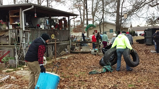 Volunteers clean-up local homeowner's yard