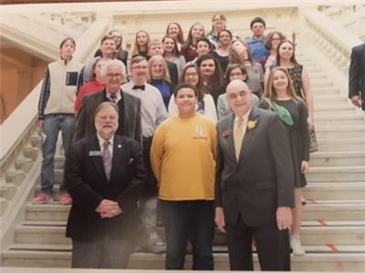 Students are pictured with Senator Jeff Mullis and Rep. John Deffenbaugh on the Capitol stairs