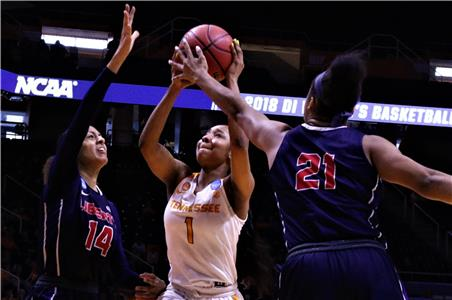 Tennessee's Anastasia Hayes (1) puts up a shot as she is defended by Liberty's Lela Sellers (14) and Keyen Green (21) in an NCAA first round game Friday afternoon at Thompson-Boling Arena, The Lady Vols (25-7) doused the Flames (24-10) by a convincing 100-60 score. With the win Tennessee will play Oregon State (24-7) on Sunday. Tip-off time is to be determined.