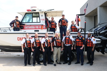 In the photo, front row, (left to right) - Fire Marshal William Matlock, Operations Chief Rick Boatwright, Fire Chief Phil Hyman, local Firehouse Subs franchise Co-Owner Tom Davidson, Assistant Chief Danny Hague, Lt. Eric Roddy and Assistant Chief Carlos Tibbs. On the fire boat (left to right) - FF Johannes Wagner, FFS Dale Aslinger, FFE Mark Jenkins and Deputy Chief Seth Miller.
