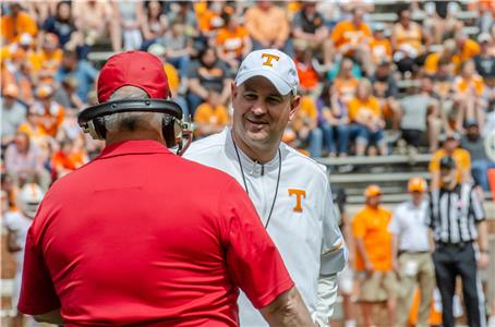 Tennessee head coach Jeremy Pruitt confers with an assistant prior to Saturday's spring game at Neyland Stadium. The first team offense bested their defensive counterparts, 34-7.