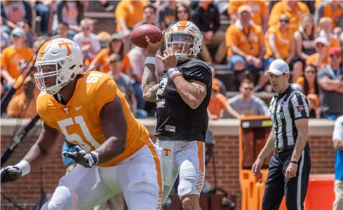 Quarterback Jarrett Guarantano (2) of the Orange team drops back to pass behind the block of Drew Richmond (51) during Saturday's Orange and White game at Neyland Stadium, Guarantano's MVP performance led the first team offense to a 34-7 win over the first team defense.