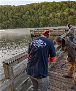 Union volunteers replaced damaged and unsafe floor boards and the top rail of a fishing pier adjacent to the boat launch at Wolftever Creek