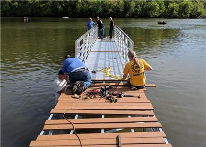 Union volunteers installed a new 104-foot-long, handicap-accessible floating pier at Wolftever Creek to make the boat dock accessible year round.