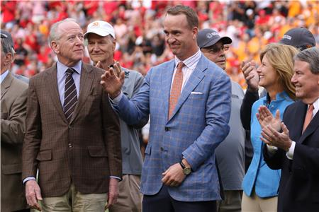 Peyton Manning, center, at his College Football Hall of Fame induction recognition during halftime of last season's game with Georgia. Manning will be inducted to the College Sports Information Directors' Academic All America Hall of fame in June.