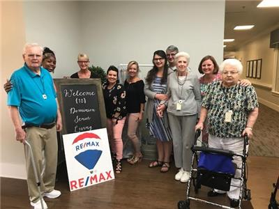 Jada Alsobrooks and Becky Parris, staff members at Dominion Senior Living Of Hixson, pictured with several of their residents, Dr Tony Collins and Rachel Collins of Burks United Methodist Church, and agents from RE/MAX Renaissance of Hixson
