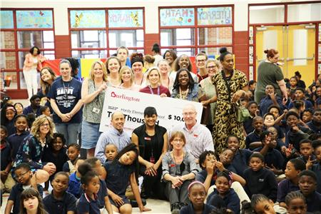 Hardy Elementary students and staff show off their check from Burlington