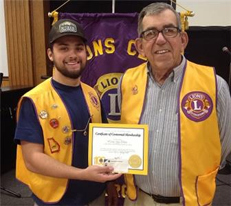 Lions President Dakota McIntire (left) welcomes Melvin Ray Nelms to the Boynton Lions Club
