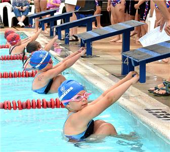 Swimmers take their positions for the girls 6 and under 25 yard backstroke.