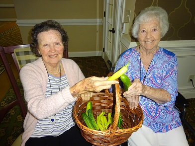 Morning Pointe of Chattanooga at Shallowford residents Louise Gork and Jane Plumlee can't wait to take a bite out of the fresh vegetables in the courtyard at the assisted living community
