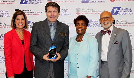 Ringgold Councilmember Randall Franks (second from left) receives the Certificate of Distinction Award from (from left) Dr. Laura Meadows, director, Carl Vinson Institute of Government; Dorothy Hubbard, immediate past president of the Georgia Municipal Association; and An'cel Davis, chair of the Municipal Training Board.