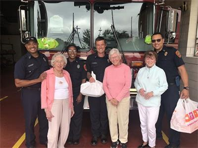 Morning Pointe of Chattanooga – Shallowford residents, from left to right, Sarah Stanely, Ruth Carmichael, and Maxine Spector present local firefighters with a number of breakfast goodies in honor of Patriot Day