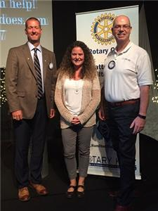 Pictured, from left to right:  Chris Neighbors, Hamilton Place Rotary Club president; Sabrina Butcher, owner of LUCYdoes, LLC; and Kevin Beirne, Hamilton Place Rotary Club member.