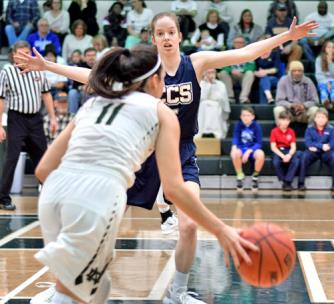 Notre Dame's Kate Ford drives against Madison Blevins of CCS.