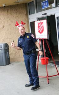 Lt. Shawn Damon rings a bell to help raise money for the Salvation Army during the 2017 Christmas holiday season