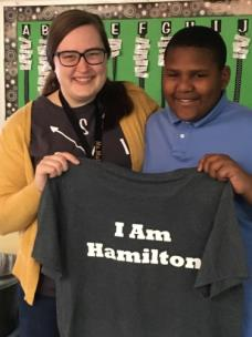 Student Jamarcus Varnell presents the shirt to his music teacher Emma Mullins