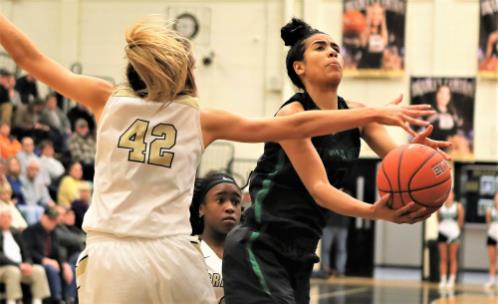 East Hamilton's Madison Hayes, right, tries to shoot while being defended by Bradley Central's Anna Walker (42) during their District 5-3A basketball game Tuesday night. Hayes was in constant foul trouble, picking up three in the first quarter, and played just 13-plus minutes and scored 11 points in a 75-38 loss.