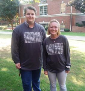 Lee students Cody Porter and Rachel Smith posing in their New Horizons Missions T-shirts