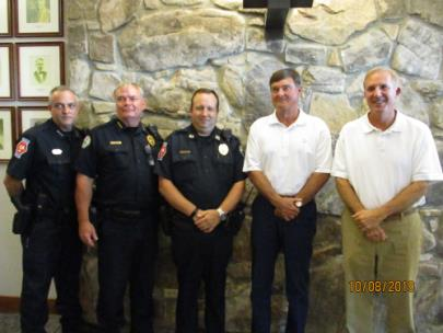 Assistant Chief Dale Taylor, Chief Chuck Wells, Captain Duane Schermerhorn, Fire and Police Commissioner Jim Bentley and Mayor Walker Jones