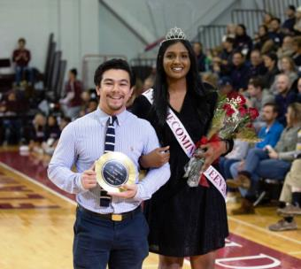 Lee's 2019 Homecoming Queen Sarah Sajja with her escort Nathan Lomboy during halftime at the Homecoming game
